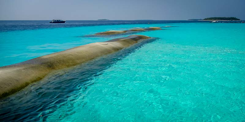 Geotextile bags to prevent beach erosion Maldives Reefscapers